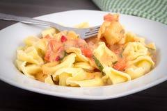 Tortellinis pasta in tomato sauce Stock Photography