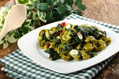 Tortellni with spinach and butter. On complex background Stock Photo
