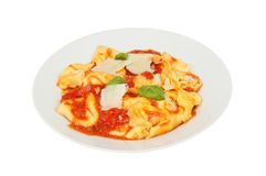 Tortelloni in a bowl. Tortelloni with tomato sauce in a bowl isolated against white Royalty Free Stock Image