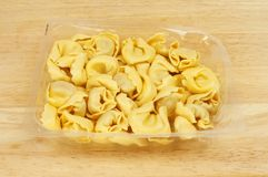 Tortelloni pasta in a carton Royalty Free Stock Images