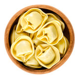 Tortelloni pasta in wooden bowl Royalty Free Stock Image