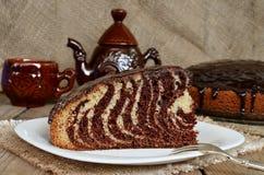 Torten-Zebra mit Schokoladenzuckerglasur Stockfotografie