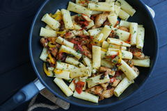 Tortiglione pasta with chicken in a sauce of tomato Royalty Free Stock Image