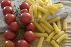 Tortiglioni and cherry tomatoes Stock Images