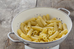 Tortiglioni Pasta in a sieve Stock Photos
