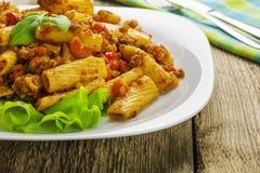 Tortiglioni with sauce bolognese Stock Photo