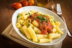 Tortiglioni with tomato Stock Images