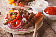 Tortilla with beef and vegetables close-up. Horizontal rustic Royalty Free Stock Photos