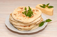 Tortilla with cheese and mint. On white plate on table Royalty Free Stock Image