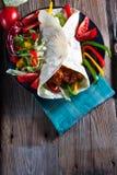 Tortilla with chili. Tortilla with chili con carne Stock Photo