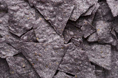 Tortilla Chip Close Up. Close up of tortilla chips made from blue corn Royalty Free Stock Photography