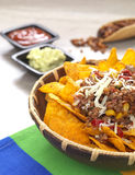 Tortilla chips. A bowl with spicy tortilla chips served with minced meat and cheese stock photos