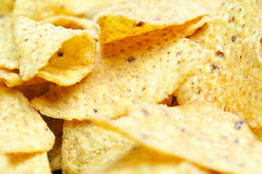 Tortilla Chips. Some tortilla/Nacho chips background. Shallow DOF, focus mostly in the middle of the image Royalty Free Stock Photos