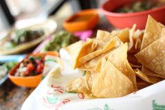 Tortilla chips in basket Stock Images