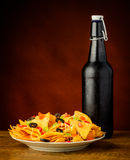 Tortilla chips and beer bottle Stock Photo