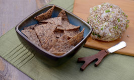Tortilla chips with cheese ball in background Stock Photo