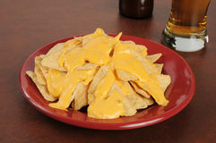 Tortilla chips with cheese sauce and beer Stock Photos
