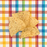 Tortilla chips on a colorful place mat Stock Photo