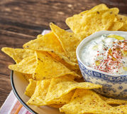 Tortilla chips and cream sauce with fresh herbs Stock Photography