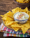 Tortilla chips and cream sauce with fresh herbs Royalty Free Stock Photography