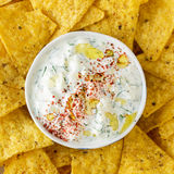 Tortilla chips and cream sauce with fresh herbs Stock Photo