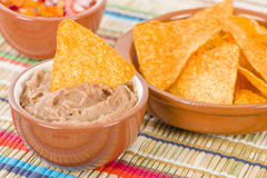 Tortilla Chips & Dips. Mexican totopos with refried beans and salsa royalty free stock photos
