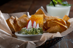 Tortilla chips with fresh guacamole Stock Photography
