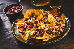 Tortilla chips garnished with cilantro and beef Stock Photo