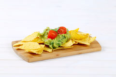 Tortilla chips with guacamole Royalty Free Stock Images