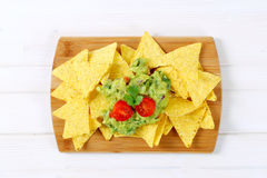 Tortilla chips with guacamole Royalty Free Stock Image