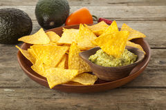 Tortilla chips, Guacamole and ingredients Stock Photography