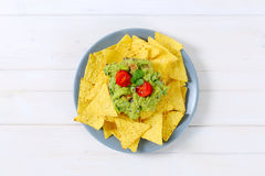 Tortilla chips with guacamole Stock Images