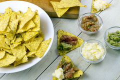 Tortilla chips with guacamole and salsa dips Stock Photo