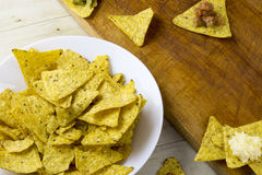 Tortilla chips with guacamole and salsa dips Stock Photos