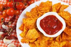 Tortilla chips with hot salsa dip. Tortilla chips with hot mexican salsa dip Royalty Free Stock Photo