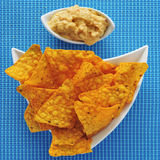 Tortilla chips and hummus Stock Photography