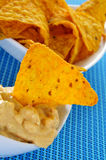 Tortilla chips and nacho cheese Stock Photo