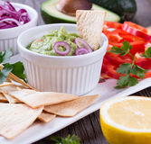 Tortilla Chips nachos, Guacamole and Ingredients Stock Photo