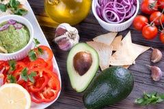 Tortilla Chips nachos, Guacamole and Ingredients Royalty Free Stock Photos