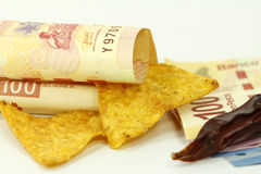 Tortilla chips and pesos. Tortilla chips and mexican pesos on white Royalty Free Stock Images