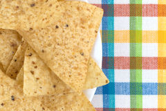 Tortilla chips on a plate and place mat Royalty Free Stock Photography
