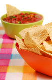 Tortilla chips with salsa. Freshly made tortilla chips with a hot and spicy salsa royalty free stock images