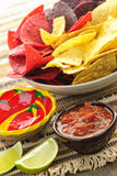 Tortilla chips and salsa. Bowl of salsa with colorful tortilla chips and lime Royalty Free Stock Photo