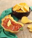 Tortilla chips with salsa dip Stock Photos