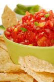 Tortilla chips with salsa and lime Royalty Free Stock Photography
