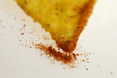 Tortilla chips. Some Tortilla chips with paprika on light background Royalty Free Stock Photo