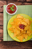 Tortilla chips with spicy tomato salsa Royalty Free Stock Photos
