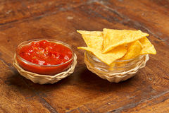 Tortilla chips and spicy tomato sauce Royalty Free Stock Photos