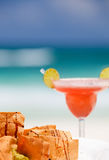 Tortilla chips and strawberry margarita cocktail stock images