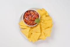 Tortilla chips and tomato salad Stock Photo